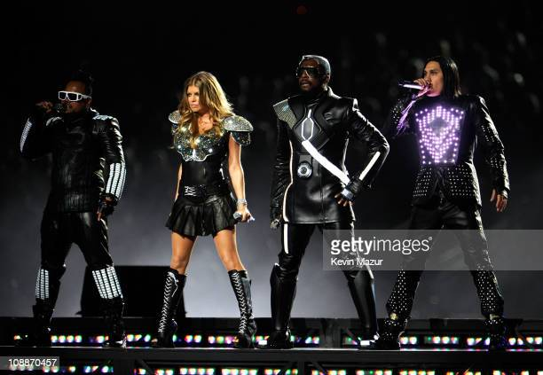 william Fergie apldeap and Taboo of The Black Eyed Peas perform during the Bridgestone Super Bowl XLV Halftime Show at Dallas Cowboys Stadium on...