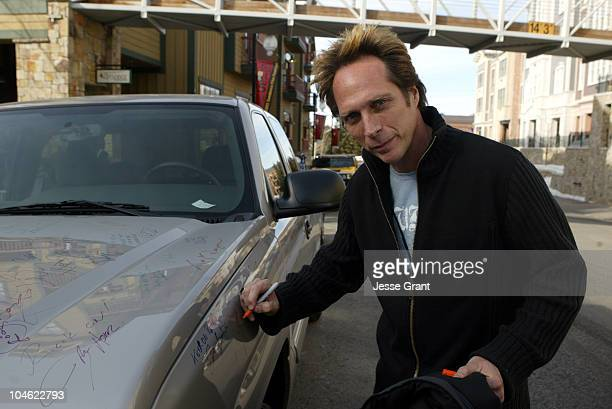 William Fichtner autographs a 2005 Chevrolet Silverado Pickup which General Motors will donate to the National Ability Center a local charity...