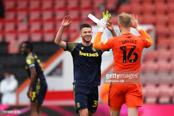 William Forrester and Adam Davies of Stoke City celebrate their side's victory after during the Sky Bet Championship match between AFC Bournemouth...