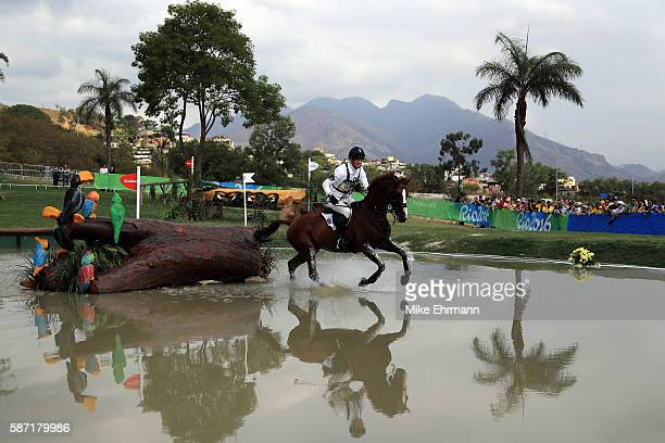 William FoxPitt of Great Britain riding Chilli Morning clears a water jump during the Cross Country Eventing on Day 3 of the Rio 2016 Olympic Games...