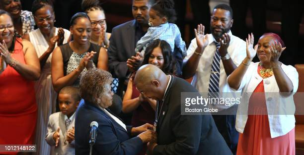 William G Gross is pinned by his mother Deanna Gross after being sworn in as Boston's 42nd Police Commissioner by Mayor Martin J Walsh at the Morning...