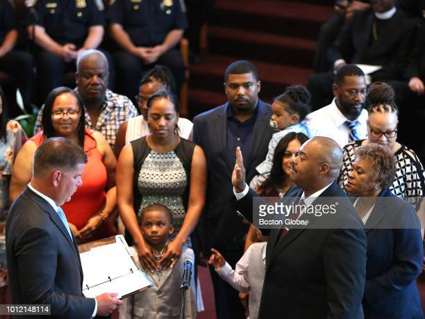 William G Gross right is sworn in as Boston's 42nd Police Commissioner by Mayor Martin J Walsh at the Morning Star Baptist Church in the Mattapan...