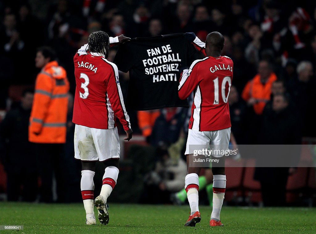 William Gallas of Arsenal (R) and Bacary Sagna of Arsenal hold a shirt in relation to the Haiti earthquake during the Barclays Premier League match between Arsenal and Bolton Wanderers at The Emirates Stadium on January 20, 2010 in London, England.
