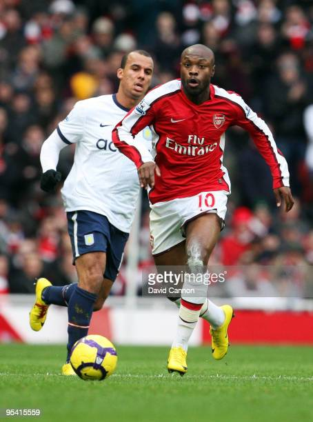 William Gallas of Arsenal battles for the ball with Gabriel Agbonlahor of Aston Villa during the Barclays Premier League match between Arsenal and...