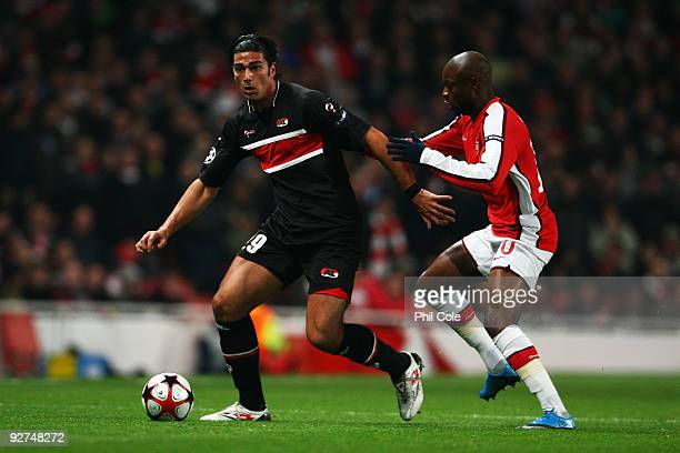 William Gallas of Arsenal chases Graziano Pelle of AZ Alkmaar during the UEFA Champions League Group H match between Arsenal and AZ Alkmaar at the...