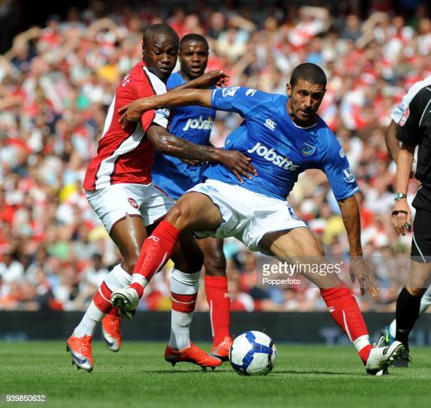 William Gallas of Arsenal tangles with Hayden Mullins of Portsmouth during the Barclays Premier League match between Arsenal and Portsmouth at the...