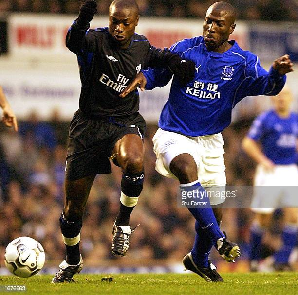 William Gallas of Chelsea is challenged by Everton captain Kevin Campbell during the FA Barclaycard Premiership match between Everton and Chelsea at...