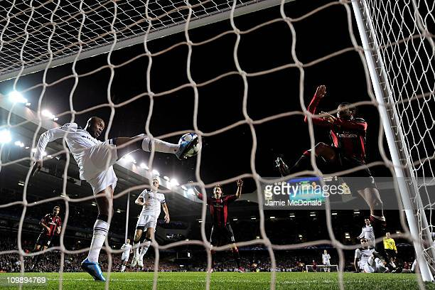 William Gallas of Tottenham clears the effort of Robinho of Milan off the line during the UEFA Champions League round of 16 second leg match between...