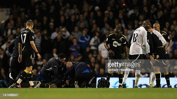 William Gallas of Tottenham Hotspur reacts as Fabrice Muamba of Bolton Wanderers lies injured on the pitch during the FA Cup Sixth Round match...