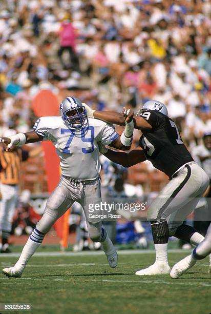 William Gay of the Detroit Lions battles against Bruce Davis of the Los Angeles Raiders during a game at the Los Angeles Memorial Coliseum on...
