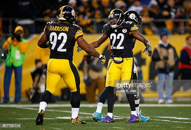 William Gay of the Pittsburgh Steelers celebrates a defensive stop with James Harrison in the first half during the game against the New York Giants...