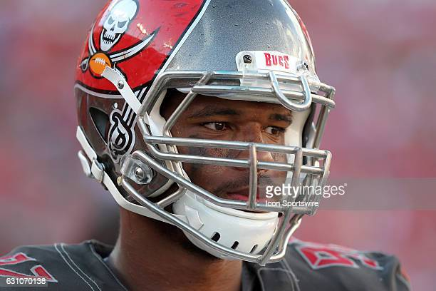 William Gholston of the Bucs walks back to the sidelines during the NFL game between the Denver Broncos and Tampa Bay Buccaneers on October 02 at...