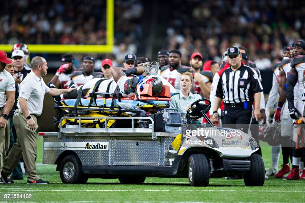William Gholston of the Tampa Bay Buccaneers is carted off the field after suffering a injury during a game against the New Orleans Saints at...