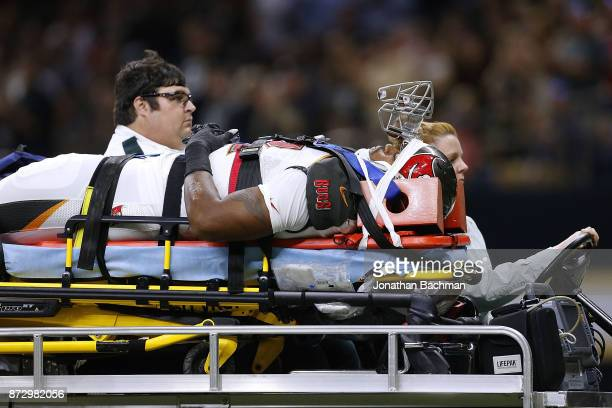 William Gholston of the Tampa Bay Buccaneers is carted off the field after an injury during the second half of a game against the New Orleans Saints...