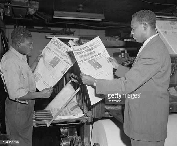 William Gordon managing editor of the African American newspaper Atlantic Daily World and pressman Kimber Boddie check a copy of the Memphis World...