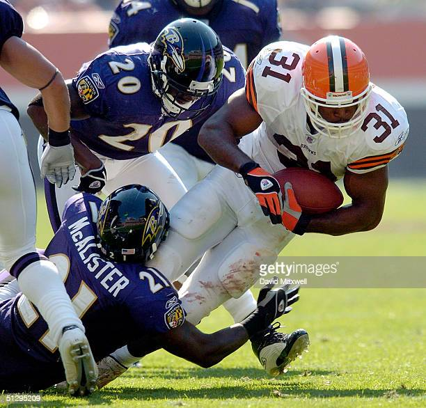 William Green of the Cleveland Browns is tackled by Chris McAlister and Ed Reed of the Baltimore Ravens during the fourth quarter on September 12...
