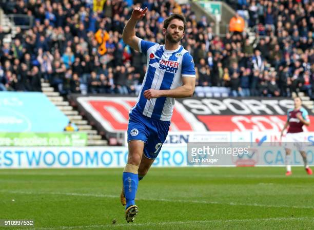 William Grigg of Wigan Athletic celebrates after scoring his sides first goal during The Emirates FA Cup Fourth Round match between Wigan Athletic...