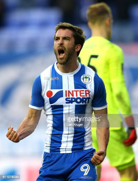 William Grigg of Wigan Athletic celebrates after scoring his sides second goal during The Emirates FA Cup Fourth Round match between Wigan Athletic...