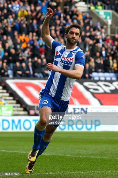 William Grigg of Wigan Athletic celebrates scoring his side's first goal during The Emirates FA Cup Fourth Round match between Wigan Athletic and...