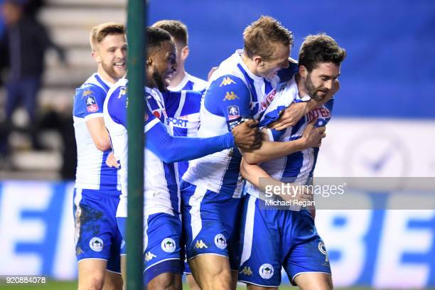 William Grigg of Wigan Athletic celebrates scoring his sides first goal with team mates during the Emirates FA Cup Fifth Round match between Wigan...