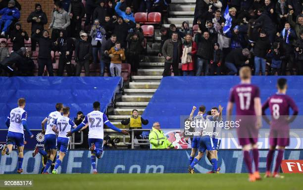 William Grigg of Wigan Athletic celebrates with teammates after scoring his sides first goal during the Emirates FA Cup Fifth Round match between...