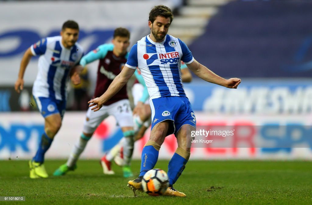 William Grigg of Wigan Athletic scores a penalty, his side's second goal during The Emirates FA Cup Fourth Round match between Wigan Athletic and West Ham United on January 27, 2018 in Wigan, United Kingdom.