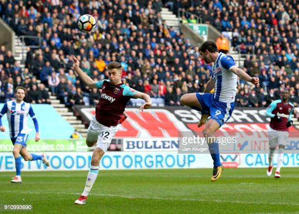 William Grigg of Wigan Athletic scores his sides first goal during The Emirates FA Cup Fourth Round match between Wigan Athletic and West Ham United...