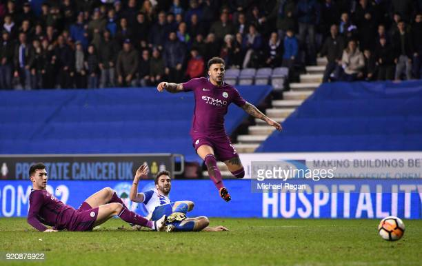 William Grigg of Wigan Athletic scores his sides first goal during the Emirates FA Cup Fifth Round match between Wigan Athletic and Manchester City...