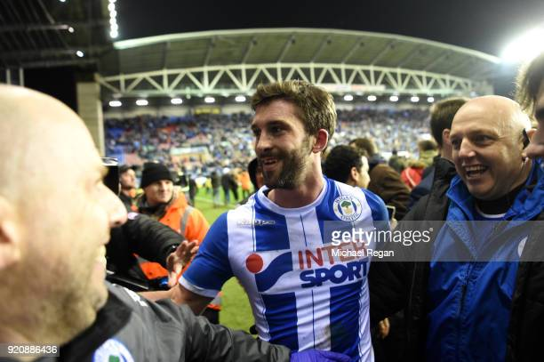 William Grigg of Wigan Athletic with fans on the pitch after the Emirates FA Cup Fifth Round match between Wigan Athletic and Manchester City at DW...