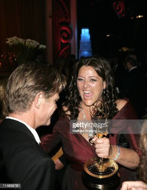 William H. Macy and Camryn Manheim holding Felicity Huffman's Emmy