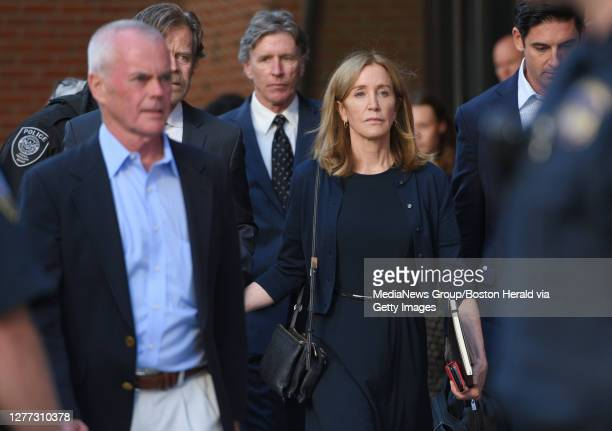 William H. Macy leaves Moakley Federal Courthouse with his wife Felicity Huffman who was sentenced to 14 days in prison for the college admission...