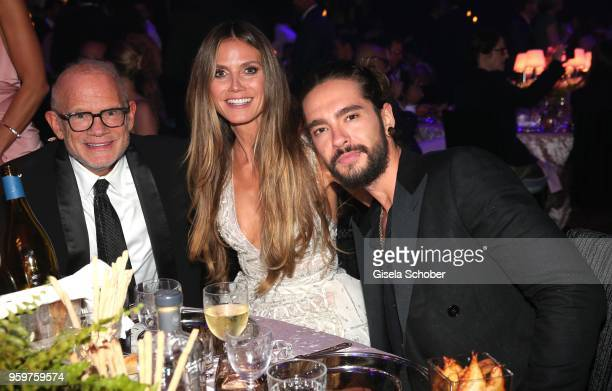 William H Roedy Heidi Klum and Tom Kaulitz during the amfAR Gala Cannes 2018 dinner at Hotel du CapEdenRoc on May 17 2018 in Cap d'Antibes France