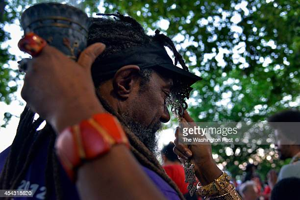 WASHINGTON DC JUNE William H Taft who has been the permit holder for the Meridian Hill Park drum circle for the past 20 years receives blessings with...