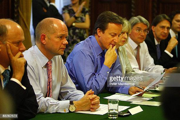William Hague the shadow foreign secretary looks on as Conservative Party leader David Cameron holds a shadow cabinet meeting at The House of Commons...