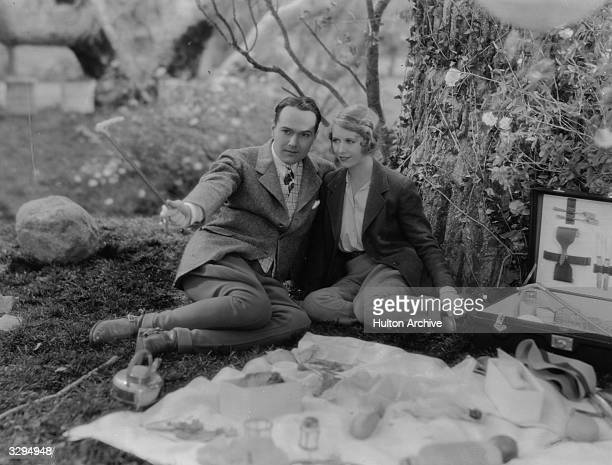 William Haines and Irene Purcell enjoy a quiet picnic in a scene from the film 'Just A Gigolo' based on the play 'Dancing Partner' by Alexander Engel...