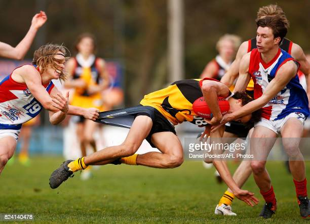 William Hamill of the Stingrays is tackled by Callum Porter of the Power during the round 14 TAC Cup match between Dandenong and Gippsland at...
