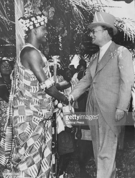 William Hare 5th Earl of Listowel the last GovernorGeneral of Ghana shakes hands with the Paramount Chief of the Volta Region of Ghana Chief Togbe...