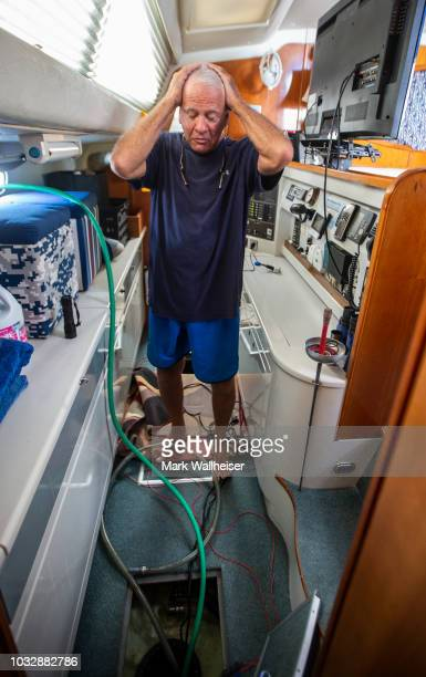 William Harrison anguishes as he bilges the hulls on his 46 foot Prout catamaran where he plans to stay during Hurricane Florence while it's moored...