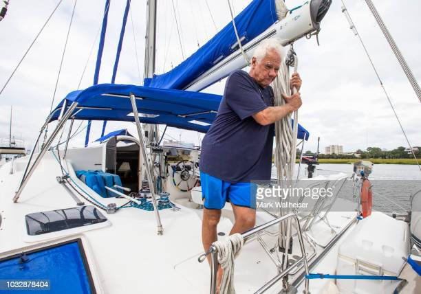 William Harrison anguishes as he looks at the engines on his 46 foot Prout catamaran where he plans to stay during Hurricane Florence while it's...