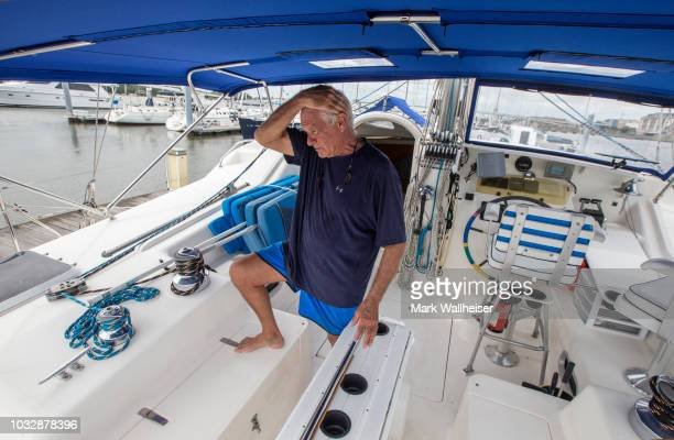 William Harrison anguishes over the engines on his 46 foot Prout catamaran where he plans to stay during Hurricane Florence while it's moored at the...