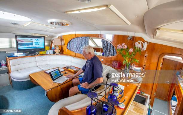 William Harrison checks the weather inside his 46 foot Prout catamaran where he plans to stay during Hurricane Florence while it's moored at the...
