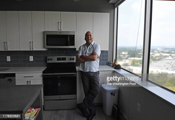 William Hart recognized the small drilled mounting holes on the window sill where his cubicle used to be in what is now the open concept living room...
