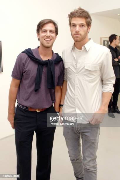 William Hathaway and PC Valmorbida attend PRISM Andy Warhol Black White at PRISM GALLERY on June 4 2010 in West Hollywood California