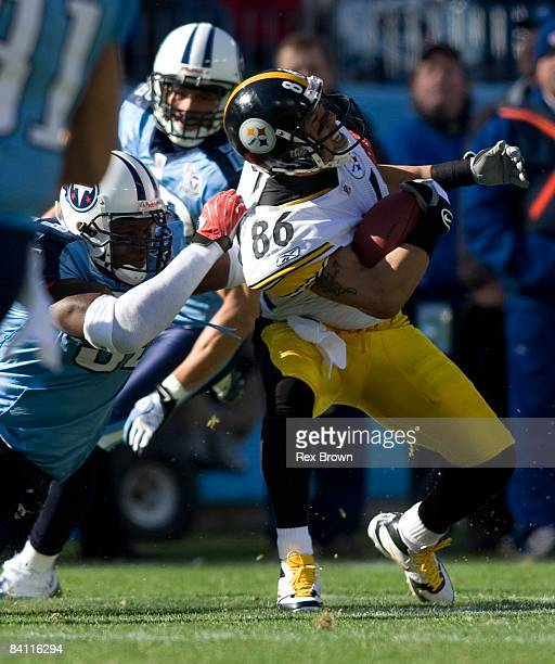 William Hayes of the Tennessee Titans tackles Hines Ward of the Pittsburgh Steelers during the first half on December 21, 2008 at LP Field in...