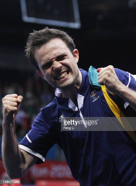 William Henzell of Australia celebrates winning his Men's Singles second round match against Joao Monteiro of Portugal on Day 2 of the London 2012...