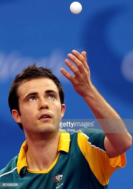 William Henzell of Australia plays against Idir Khourta of Algeria during the Men's Singles Preliminary Round held at the Peking University Gymnasium...