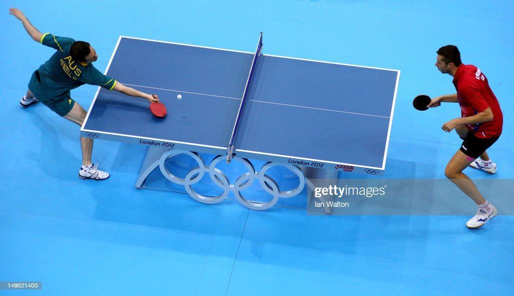 William Henzell of Australia (L) returns the ball during his Men's Singles Table Tennis third round match against Vladimir Samsonov of Belarus on Day 3 of the London 2012 Olympic Games at ExCeL on July 30, 2012 in London, England.