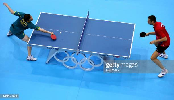 William Henzell of Australia returns the ball during his Men's Singles Table Tennis third round match against Vladimir Samsonov of Belarus on Day 3...