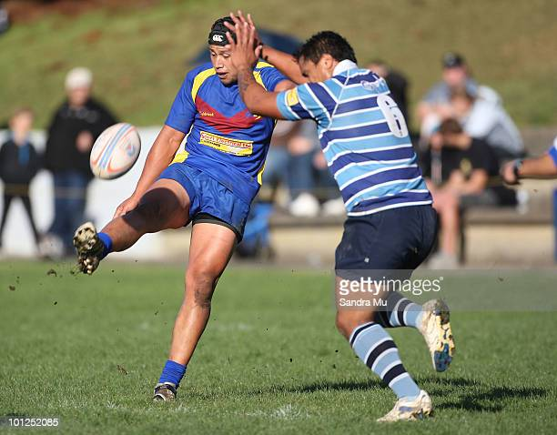 William Hete of the Leopards attempts to block the kick from Jason Tavita of the Hornets during the Fox Memorial Championship match between the...
