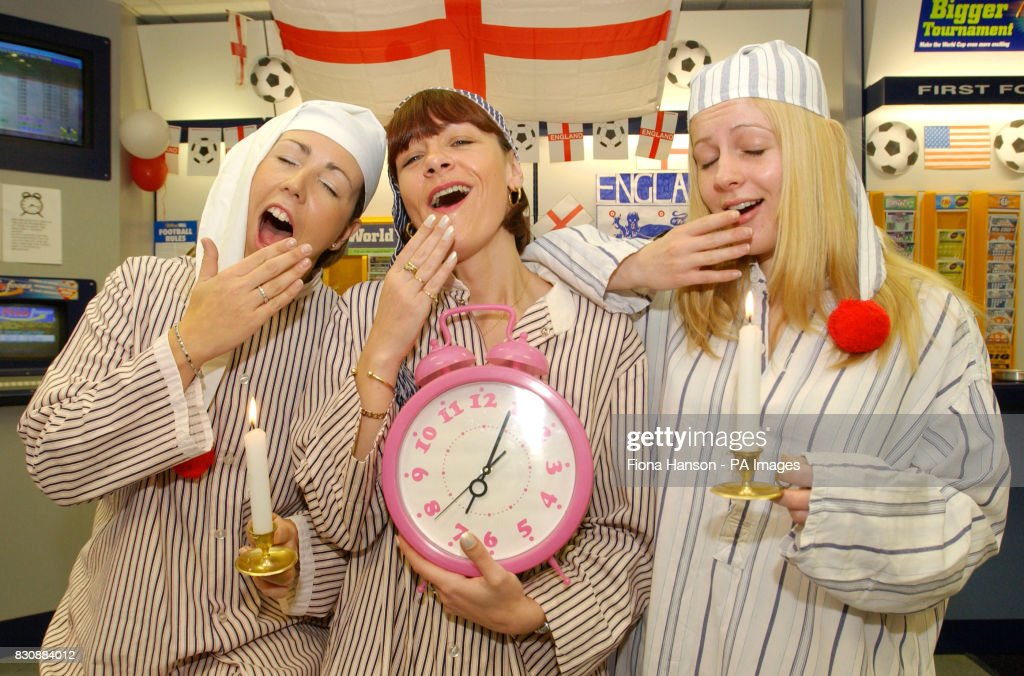 William Hill betting shop staff open up in their nightclothes at 7.00am, in London, in readiness for England's early kick off against Nigeria at 7.30am in Sapporro, Japan.